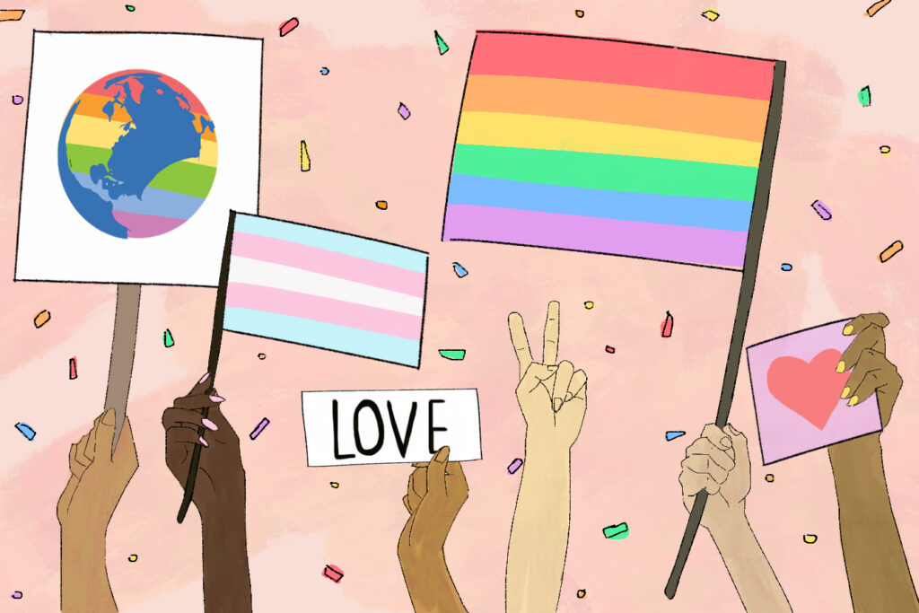 LGBTQ+ flags and arms raised